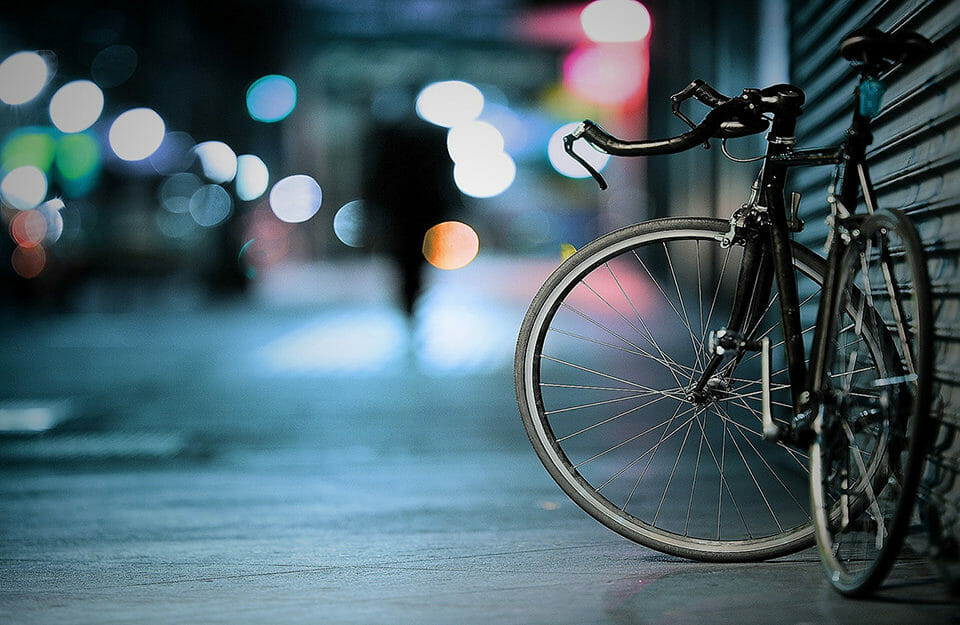 Bike on the street at night.