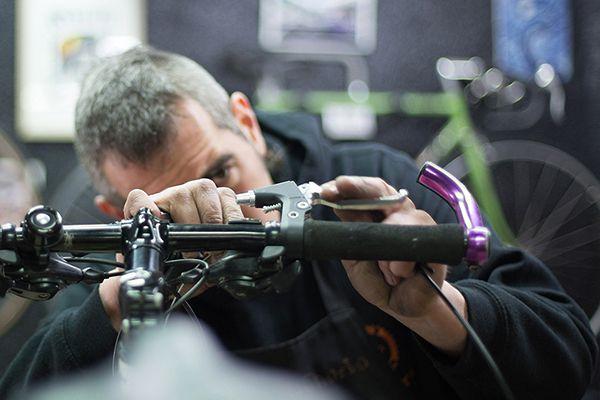 man repairing a bike in his workshop