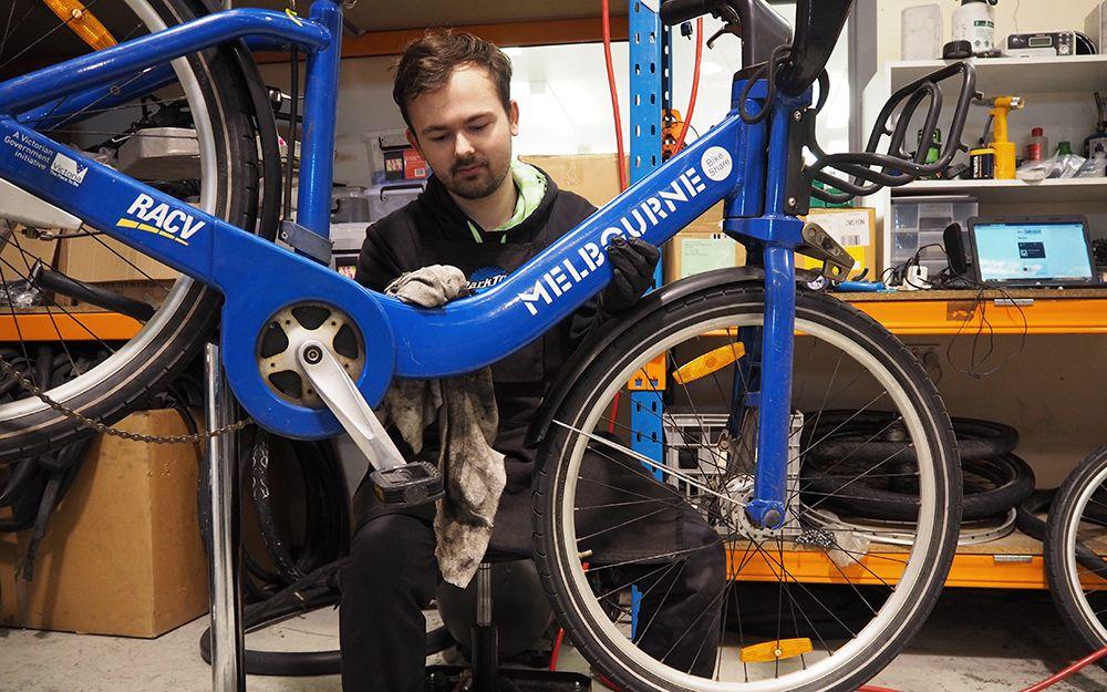 Nathan fixing a bike at Good Cycles.