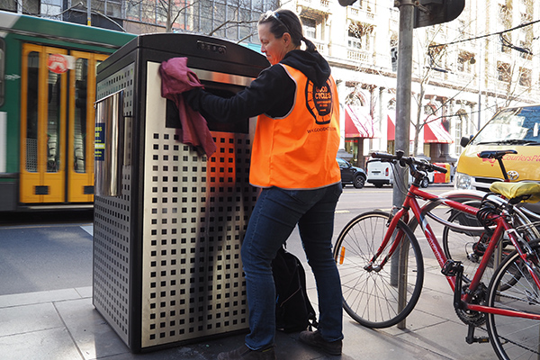 Cleaning a solar bin in City of Melbourne.