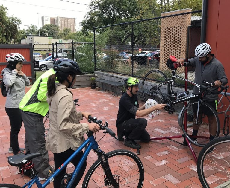 Introduction to cycling program participants learning how to maintain their bikes