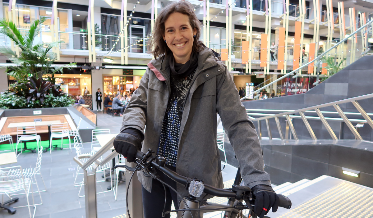 Kate with an ebike and gloves on