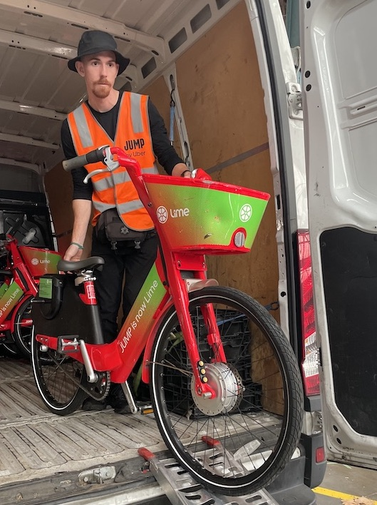 A Lime ebike being relocated